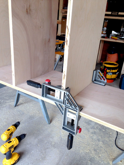 Attaching the Shelves to Make DIY Built-In Bookshelves