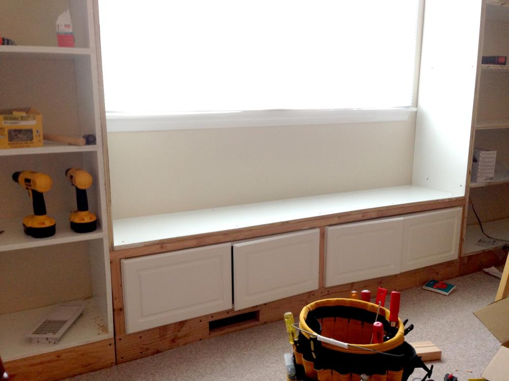 Installing Cabinets Under the Window Seat - DIY Built-In Bookshelves