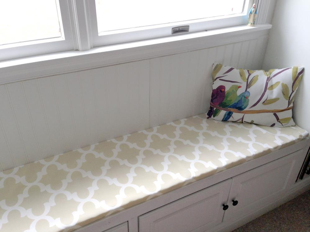 Gorgeous Window Seat stationed between two DIY Built-In Bookshelves