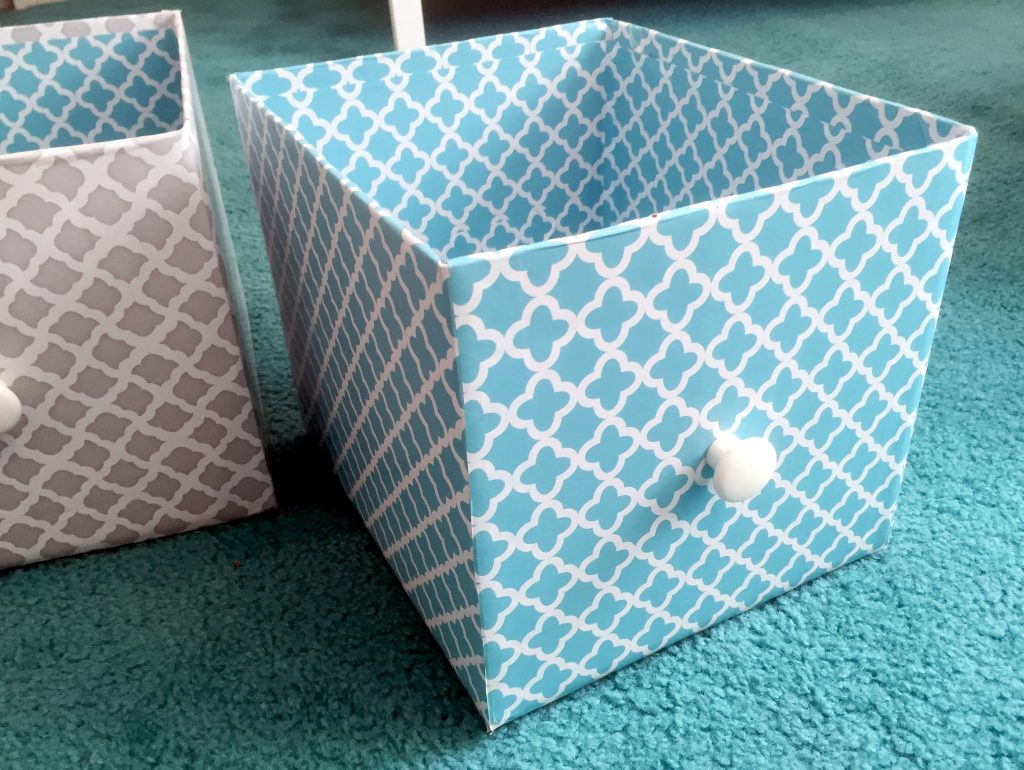Gray and blue DIY storage boxes made from cardboard