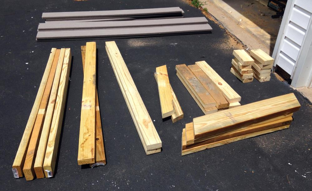 Organizing wood for building a DIY picnic table from 2x4s and composite decking