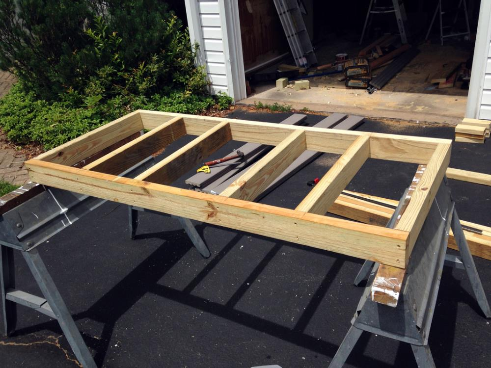 Assembling the tabletop on the homemade DIY picnic table