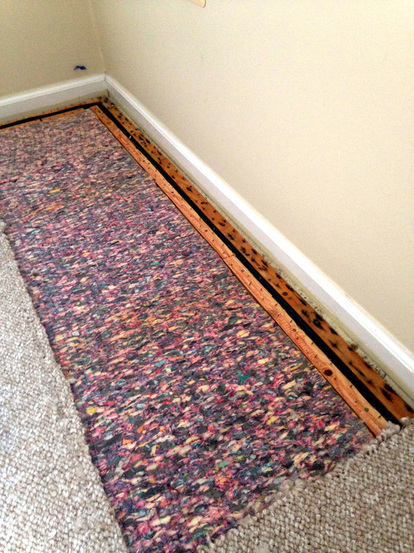 Prepping the Floor for the Easy DIY Bookcases - removing carpet