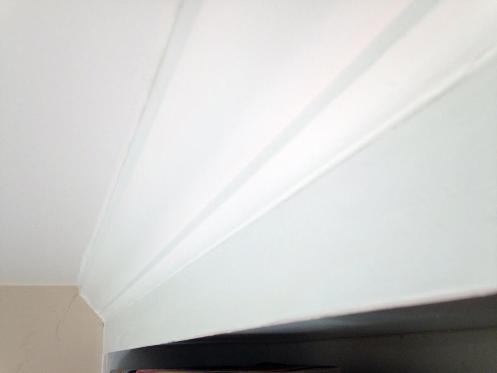 Installing Crown Molding on the Floor to Ceiling Built-In Bookshelves