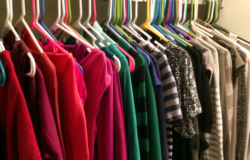 Clothing in closet organized by color - tip for staging and sell homes