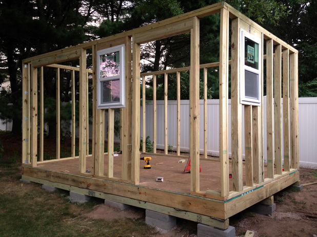 Installing wall panels on the DIY shed - learning to build your own shed