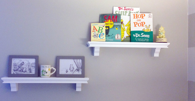 Simple wall shelves with books and pictures in a gray nursery - decluttering to get home ready to sell