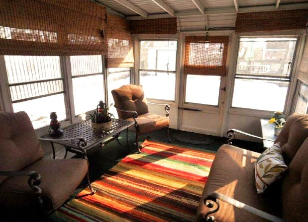 Indoor outdoor sunroom porch staged to sell home quickly
