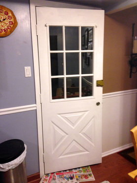 White painted back door with blue wall - how to get a house ready to sell quickly
