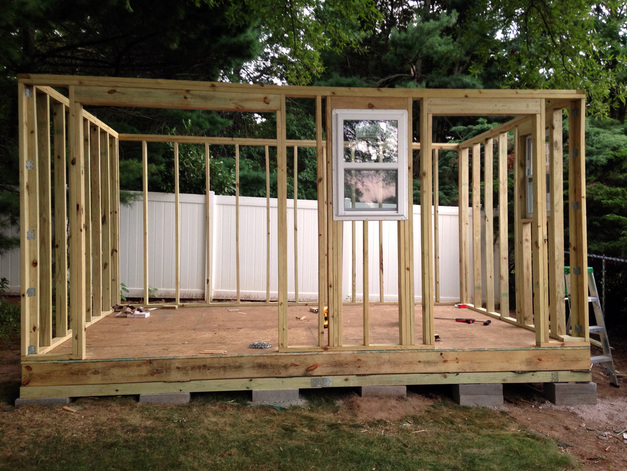 Install wall panels on the DIY shed