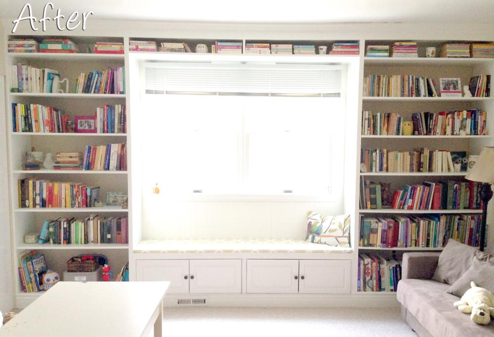 Sitting room with beautiful built-in bookshelf unit around a window with cabinets underneath