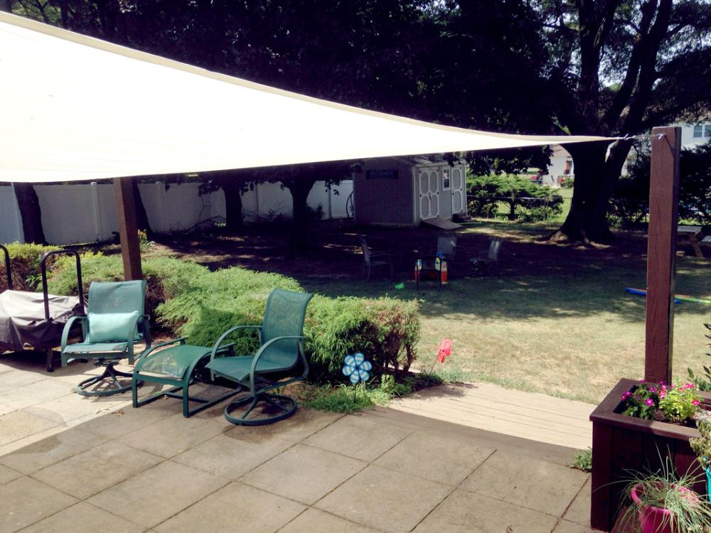 Learn how to install a DIY sun shade sail on your deck or patio