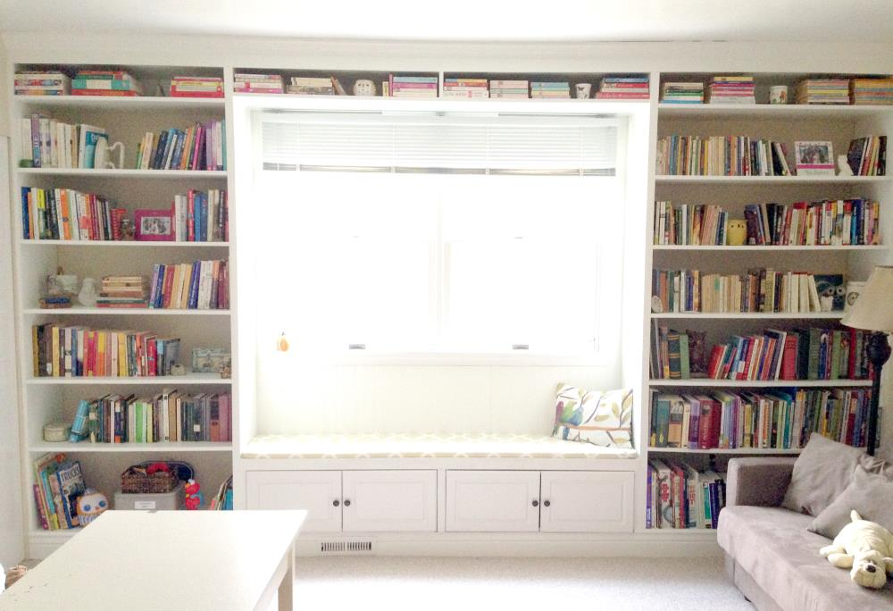 diy built-in bookshelves and cabinets around a window - floor-to-ceiling diy bookcase unit