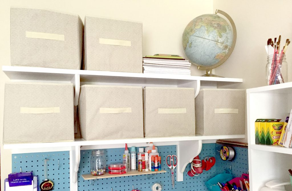Organizing the craft room with pegboard, simple wall shelves, and cubbies