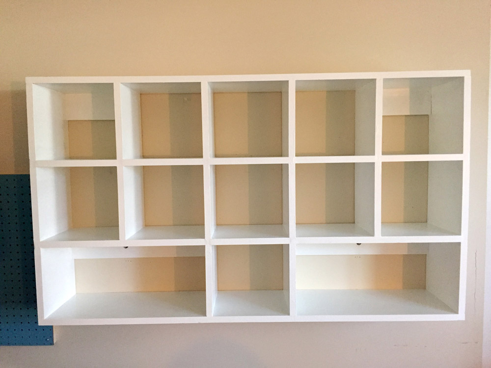 Mounting DIY Cubby Shelves to Wall - free DIY plans