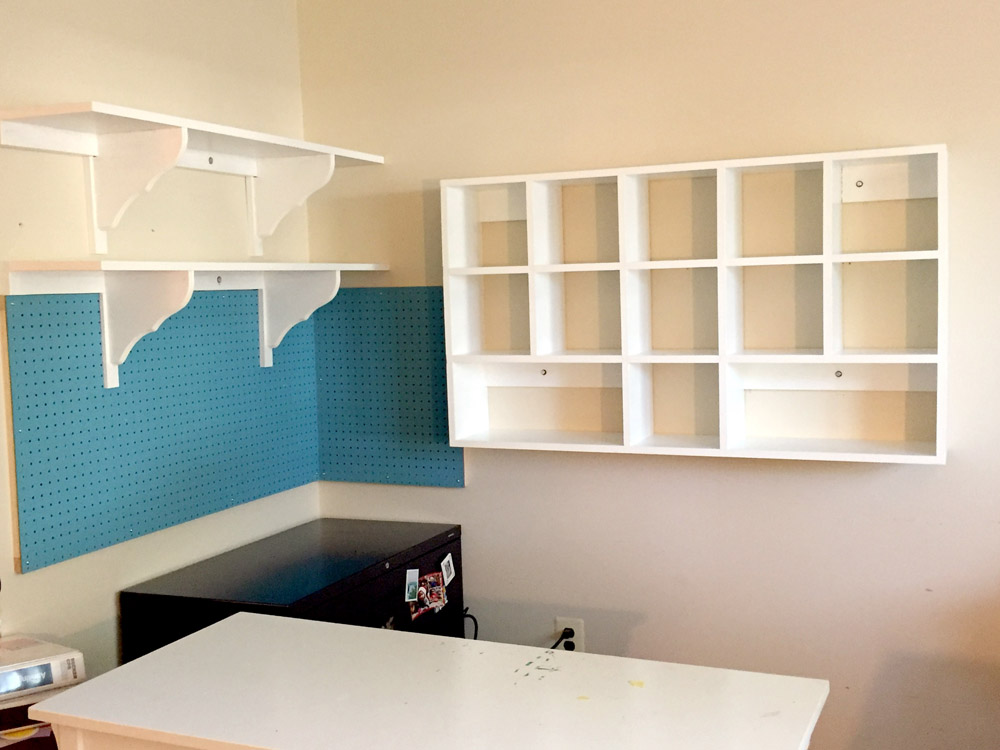 Organizing a craft room with wall shelves, cubbies, and pegboard - perfect for craft rooms