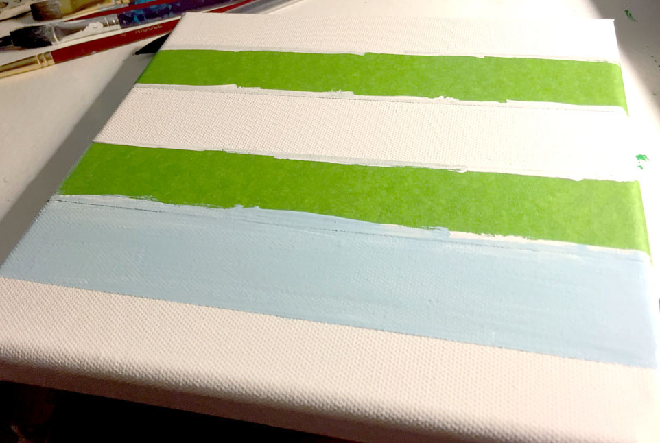 Painting Stripes on Canvas to Make DIY Wall Art for Kids Rooms