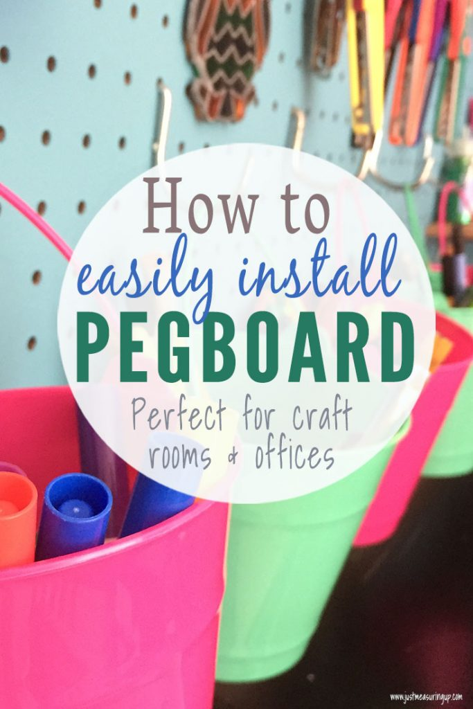 Organize your craft room with pegboard and dollar store buckets