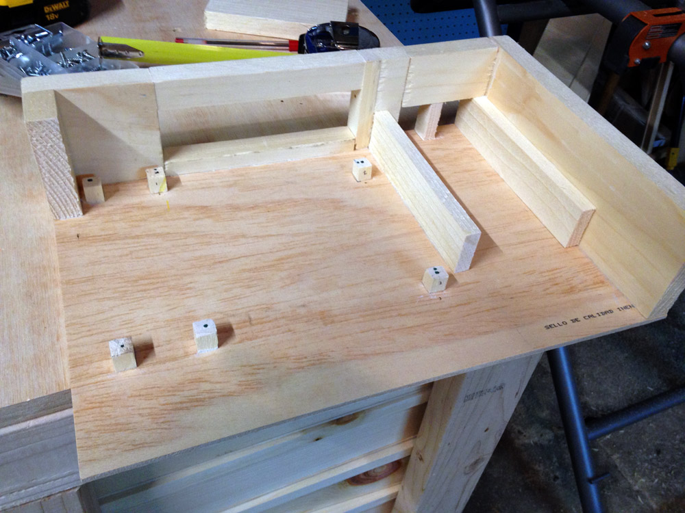 Motherboard risers on a DIY wooden computer case