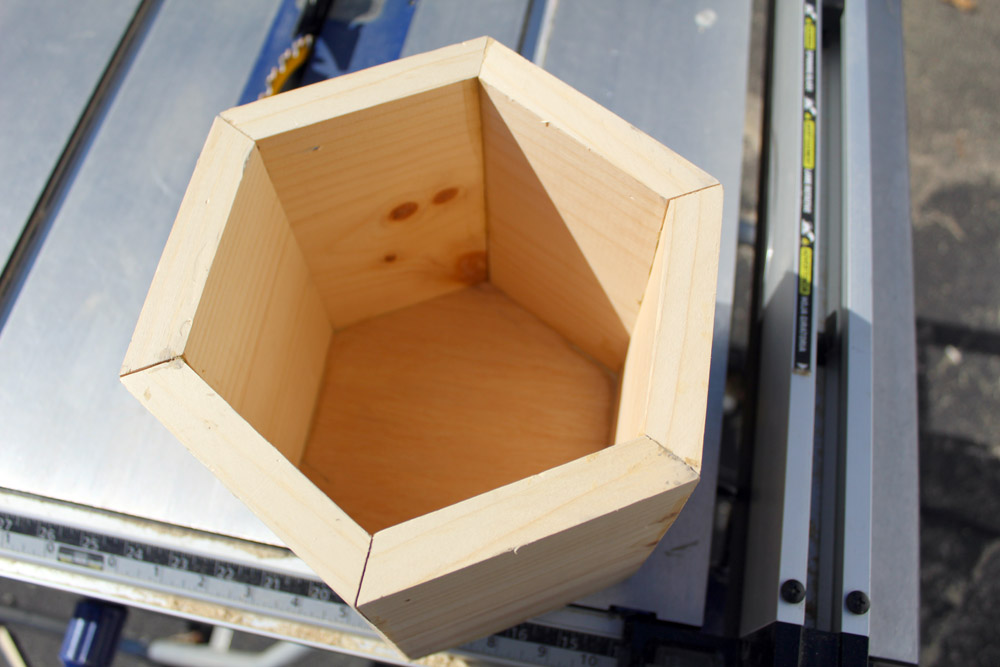 Hexagonal planter box made of wood