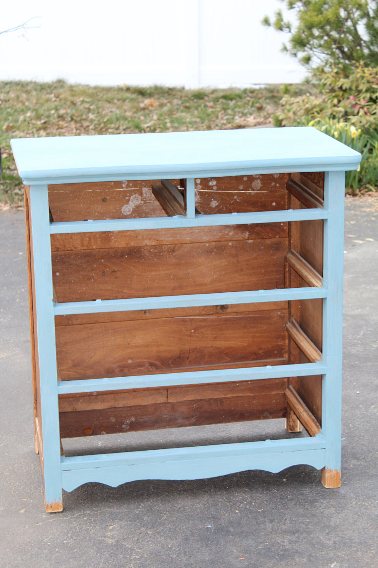 Using milk paint to paint an old dresser