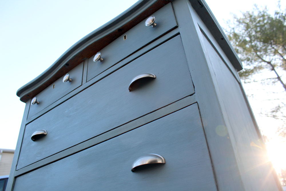 Gray Blue dresser after being paint with milk paint with the sky in the background