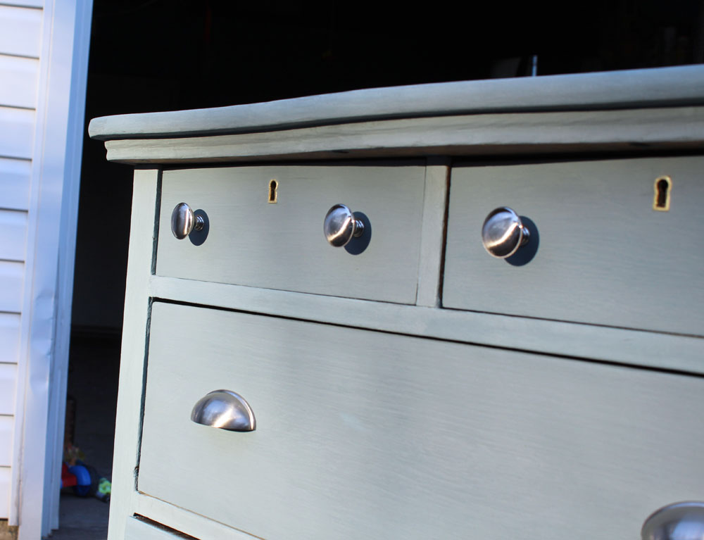 Using French gray milk paint on an old dresser to make it brand new again