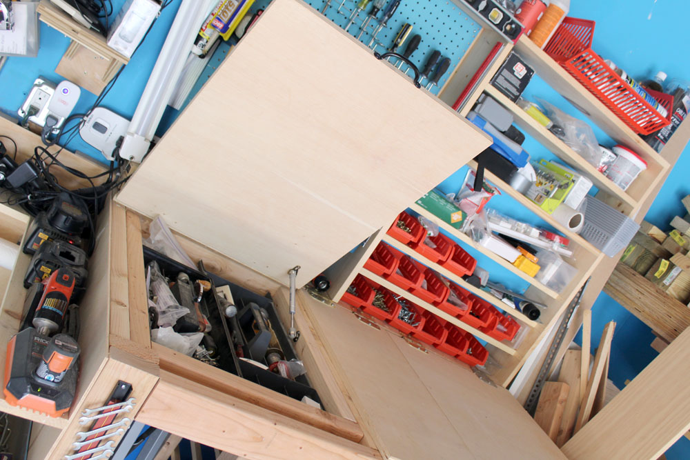 Creating hidden storage in workbenches for extra DIY garage organization tricks