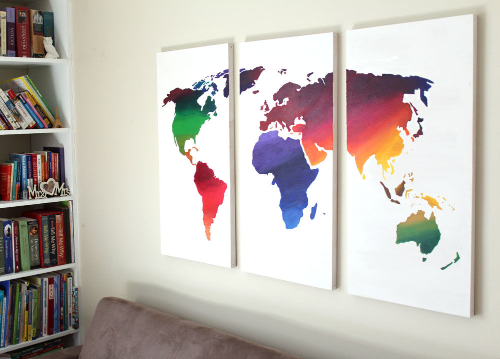 Using a world map stencil to create DIY wooden wall art canvases