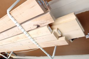 Using overhead storage in the garage for extra organization and space