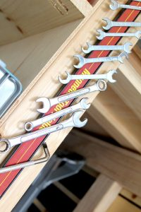 Using magnetic strips to organize garage tools
