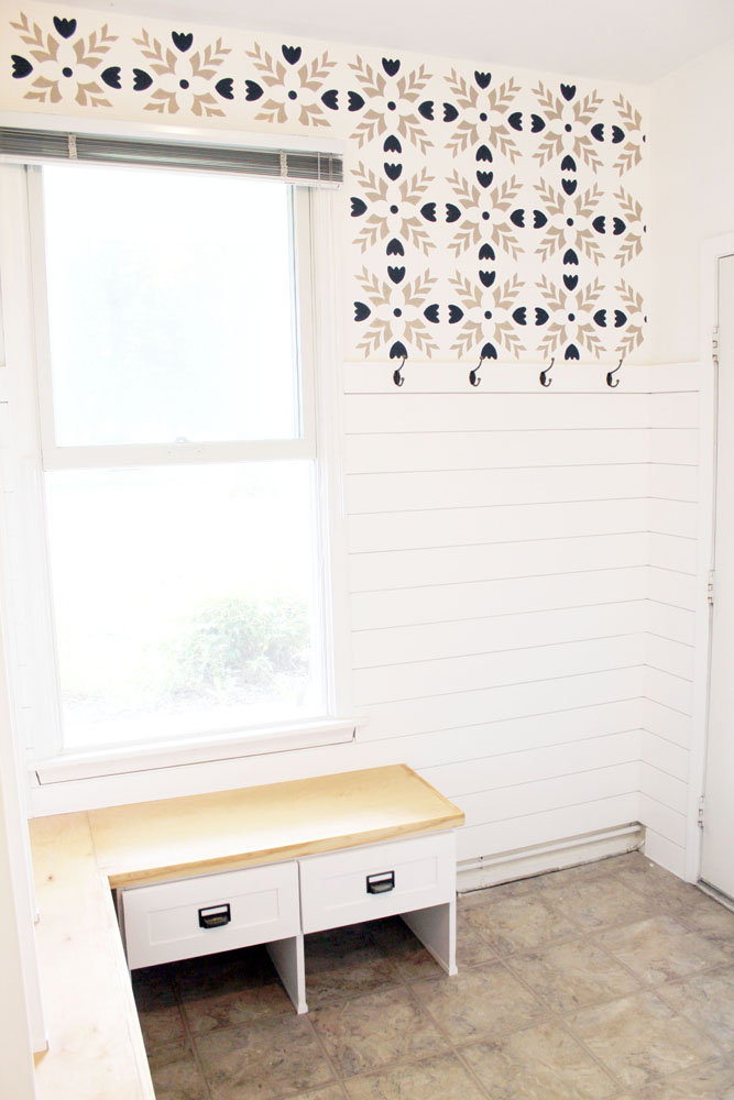 Mudroom with DIY bench, stencils and shiplap accent wall