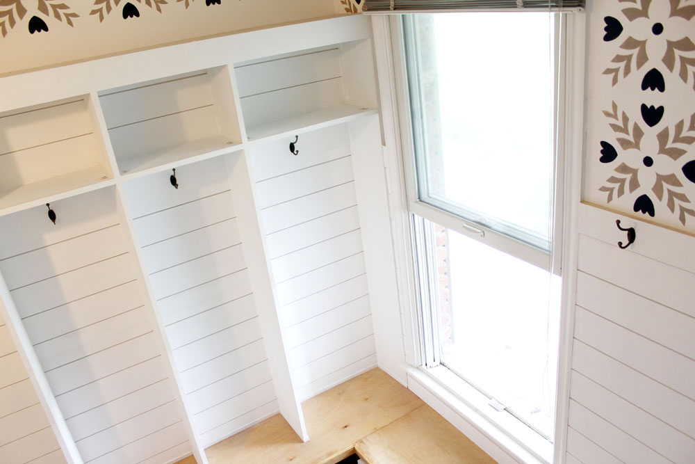 Mudroom locker-style cubbies with shiplap backing