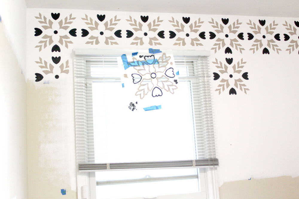 Using a wall stencil to paint an accent wall with acrylic paint