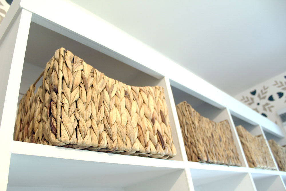 Wicker storage baskets used on cubby shelves in mudroom
