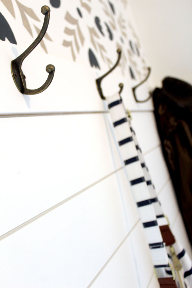 Hooks and shiplap with a stenciled accent wall