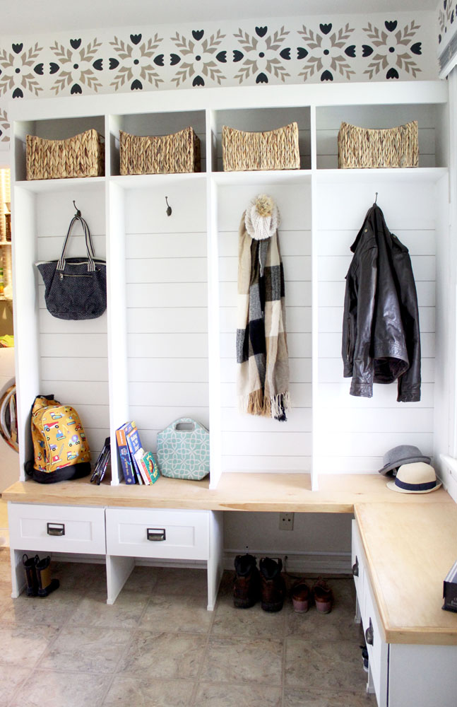 Mudroom cubby locker system for hanging coats, bags, and winter things with shiplap and a stenciled wall