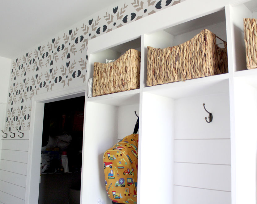 Mudroom with locker cubbies for organization and stencils and shiplap for character in the home