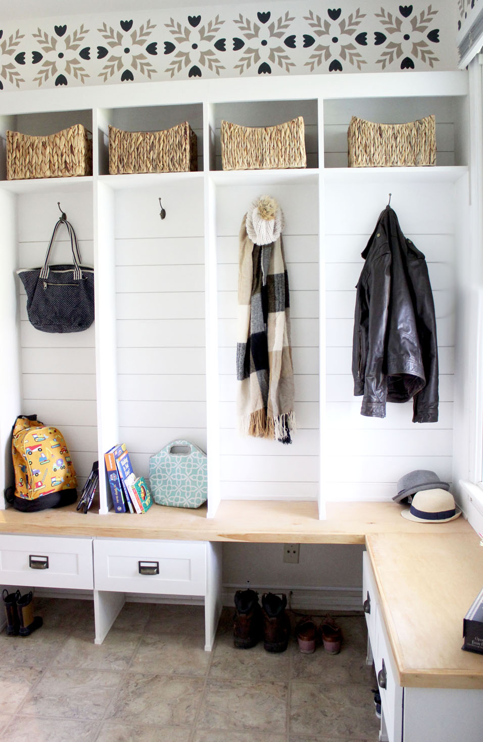 Cubby shelves in mudroom holding various belongings