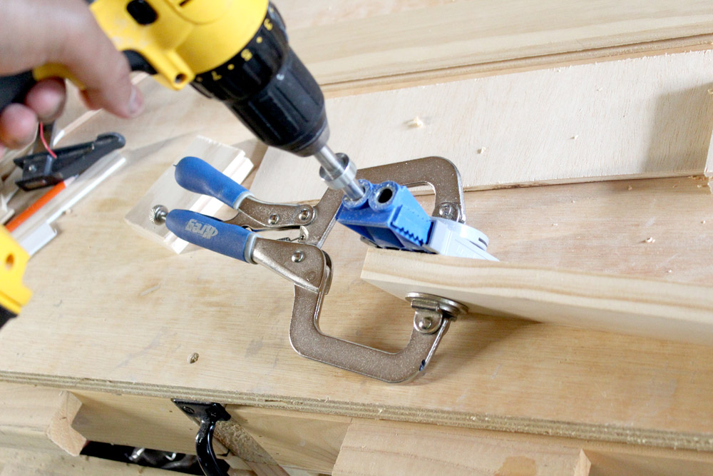 Drilling pocket holes into drawer front pieces to make shaker-style drawer fronts