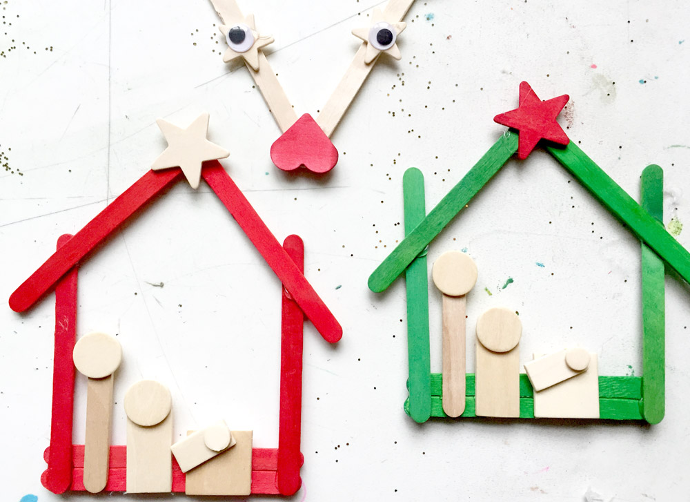 Homemade nativity scene ornament using popsicle sticks and wooden shapes
