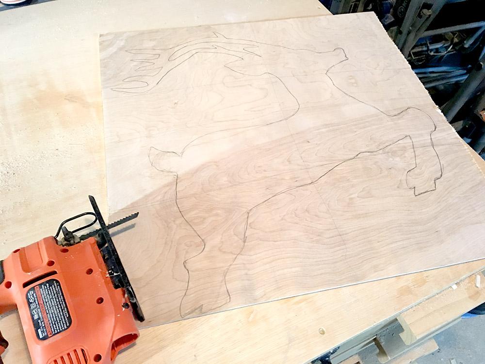 Reindeer drawn on plywood to make yard decor