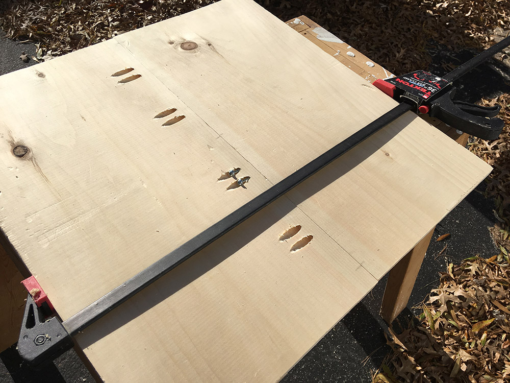 Clamping boards together to connect with pocket holes