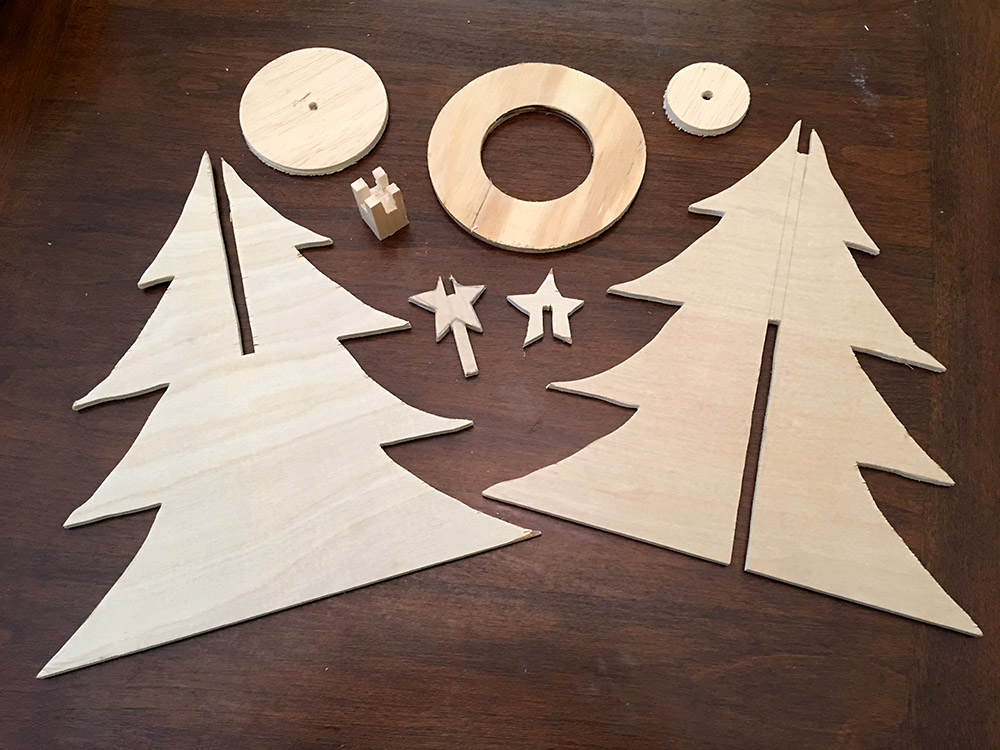 Pieces to create 3D wood Christmas tree with star and stand