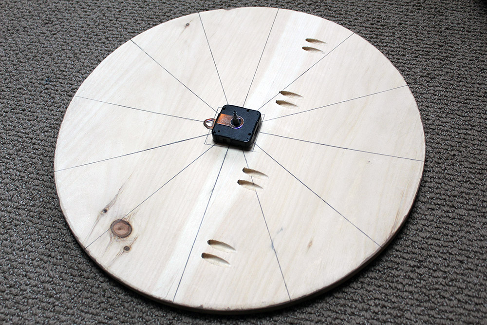 Marking the number positions on the DIY wooden wall clock