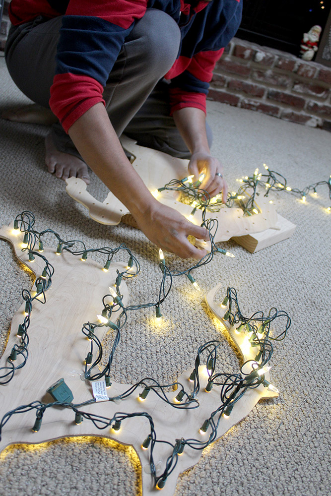 Attaching lights to DIY yard decor Santa's sleigh and reindeer