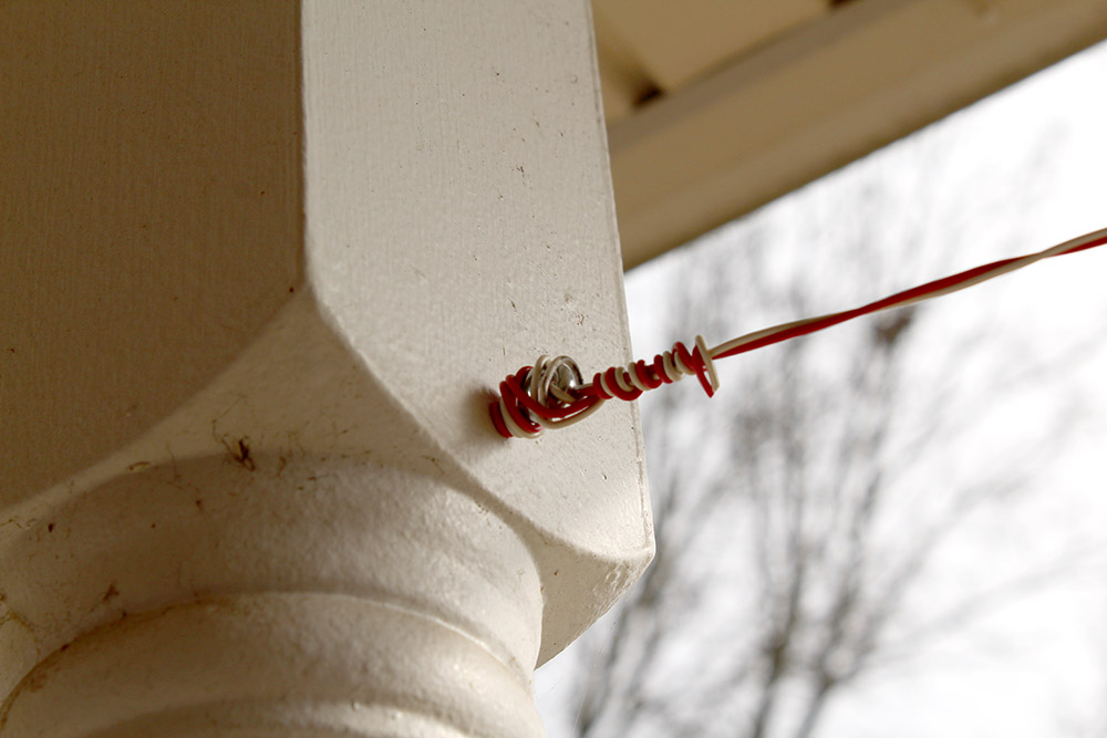 Adding eye hooks to porch posts to hold hanging yard decorations