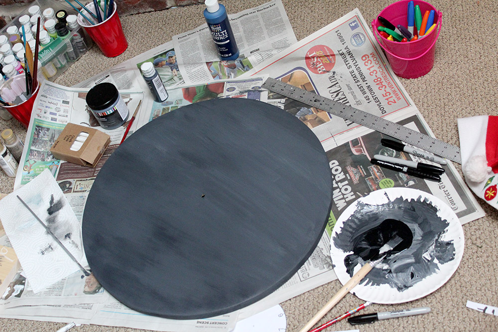 Painting the DIY wall clock chalkboard black using this easy tutorial