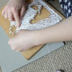 Finishing up wrapping the string around the nails on the DIY nativity scene string art project