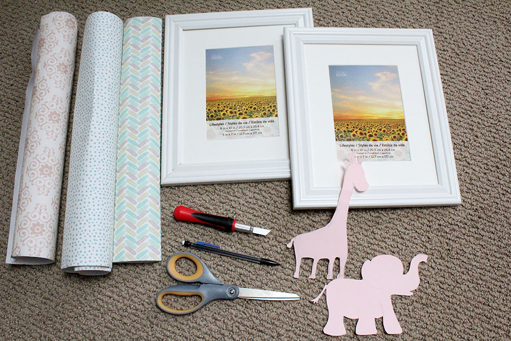 Adhesive fabric, pictures frames, and baby animal templates to make nursery wall art